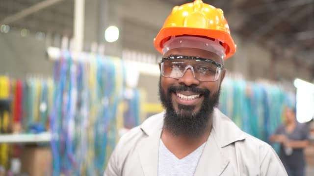 Portrait of a man working in industry Portrait of a man working in industry manufacturing occupation stock videos & royalty-free footage
