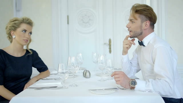 Portrait of a romantic dating couple talking at a restaurant video