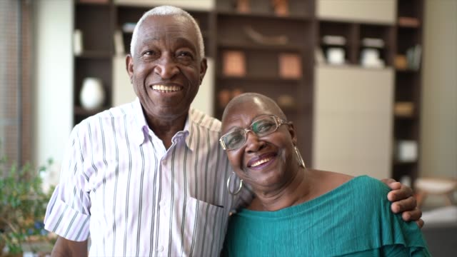 Portrait of a senior couple at home Portrait of a senior couple at home satisfaction stock videos & royalty-free footage