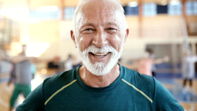 Portrait of a senior man at dance class in slow motion