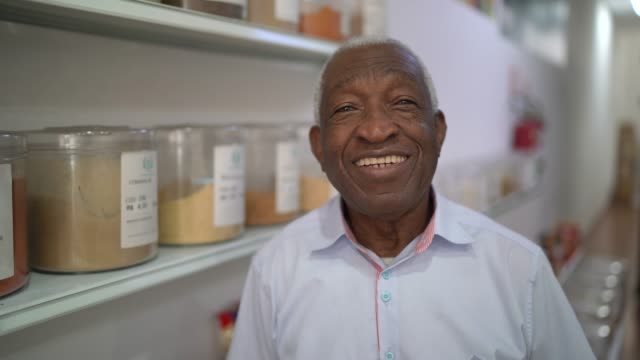Portrait of a senior man standing in a natural product store