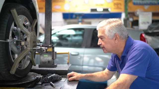 Portrait of a senior mechanic in a auto repair shop