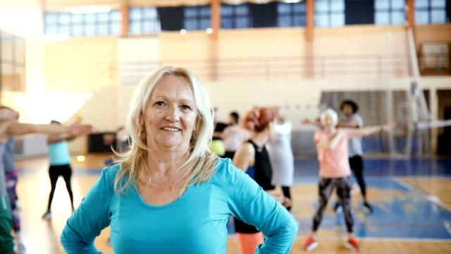 portrait of a senior woman at dance class in slow motion - body positive video stock e b–roll