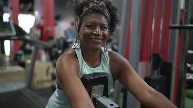 Portrait of a senior woman doing exercise at the gym