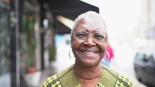 Portrait of a senior woman in the street Portrait of a senior woman in the street real life stock videos & royalty-free footage