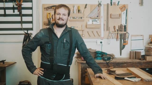 Portrait of a serious carpenter (slow motion)