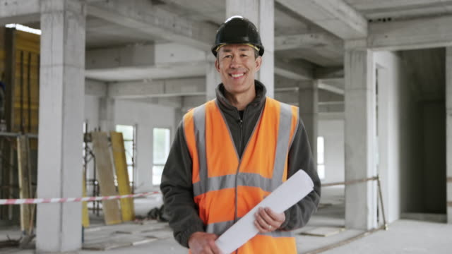 Portrait of a smiling Asian male architect