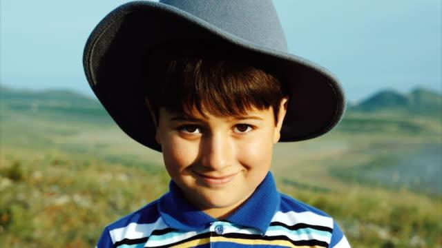 Portrait of a smiling boy in a felt hat video