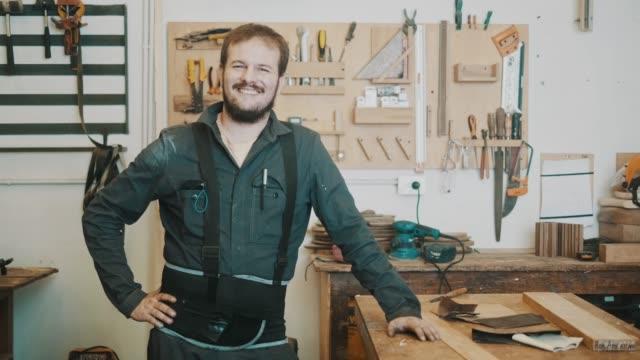 Portrait of a smiling carpenter (slow motion)