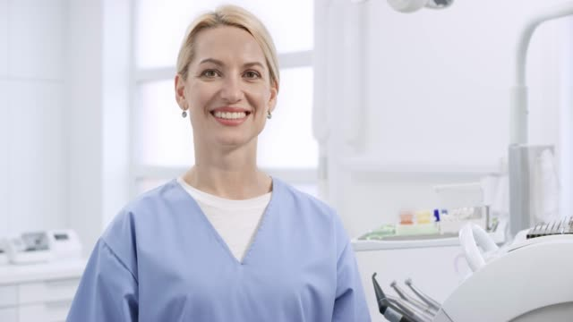 portrait of a smiling caucasian oral hygienist - dentist stock videos & royalty-free footage