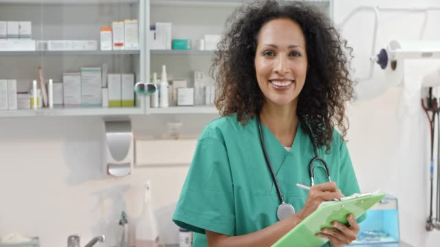 Portrait of a smiling female veterinarian making notes