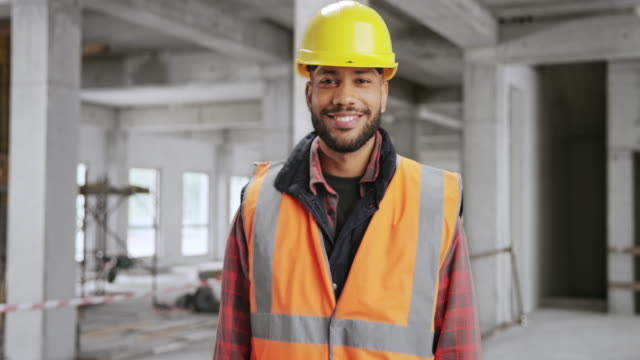 Portrait of a smiling young male construction worker video