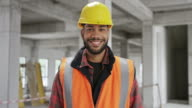 istock Portrait of a smiling young male construction worker 1164128005