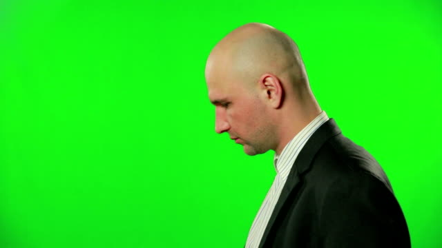 Portrait of a surprised businessman against a green screen video