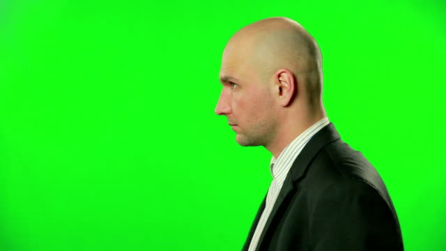 Portrait of a thinking businessman against a green screen video