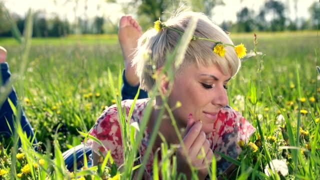 HD DOLLY: Portrait Of A Woman Blowing Dandelion video