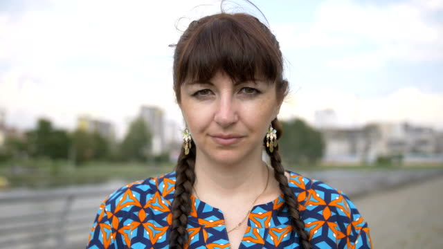 portrait of a woman looking at the camera and smiling video