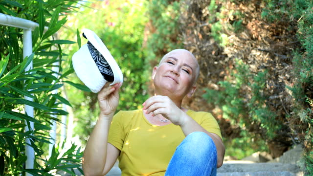 portrait of a woman with cancer sitting at the outdoor - cancer patient stock videos & royalty-free footage
