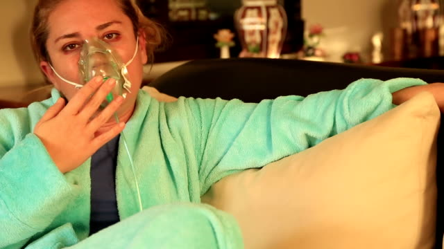 Portrait of a woman with oxygen mask video