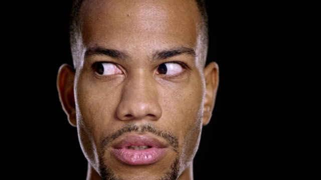 Portrait of a young African-American male moving his eyes around