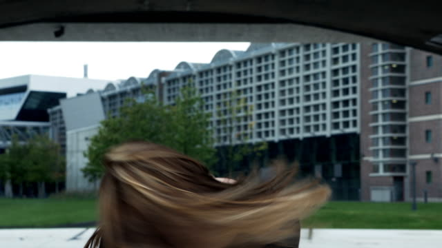 Portrait of a Young Attractive Woman Hair Swinging and Smiling video