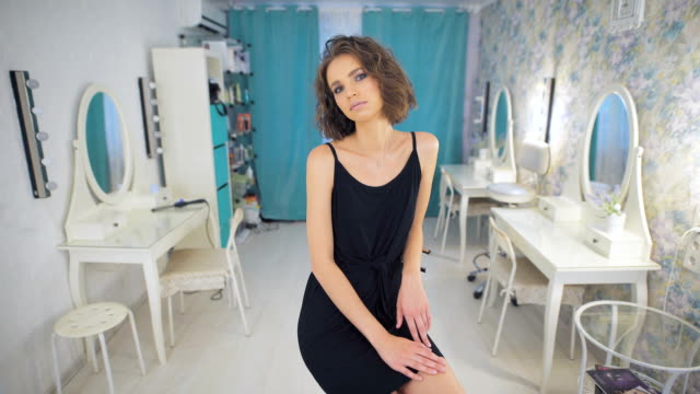 portrait of a young beautiful brunette girl in beauty salon - prom fashion stock videos and b-roll footage