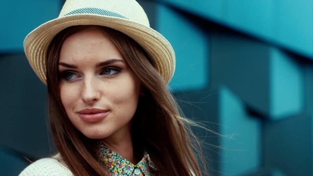 CU RL PAN SLOW MO Portrait of a young beautiful Caucasian female wearing vintage straw hat video