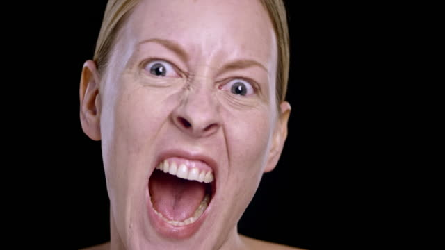 Portrait of a young Caucasian woman screaming video