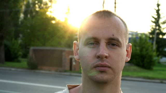portrait of a young man outside ,with wounds and scratches on his face video