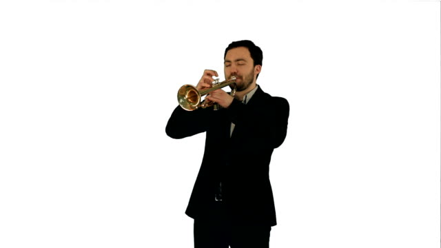 Portrait of a young man playing his Trumpet on white background isolated video