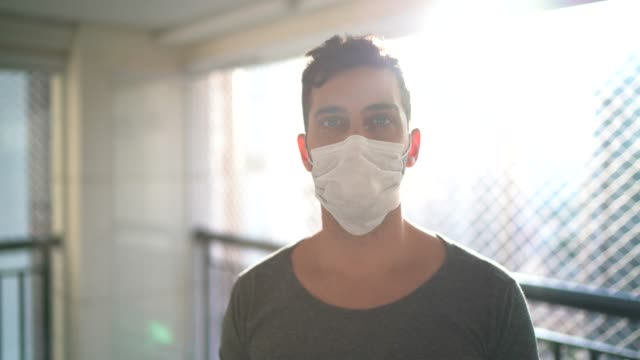 Portrait of a young man wearing face mask at home