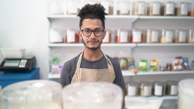 Portrait of a young seller standing in a natural products shop