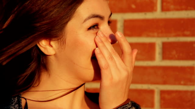 portrait of a young woman crying with unexpected joy. - strillare video stock e b–roll