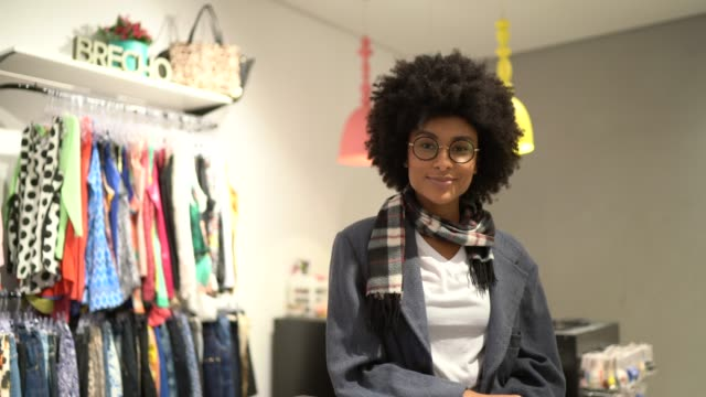 Portrait of a young woman standing in a store