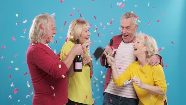 Portrait of Active Senior Couples Celebrating New Year's Eve video