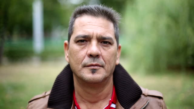 Portrait of adult cuban man looking at camera video