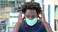 istock Portrait of African Man Wearing Face Mask 1212122079