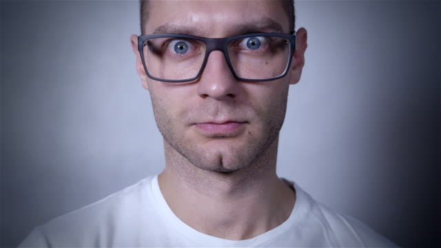 Portrait of amazed, scared man wearing eye glasses. Close up. video