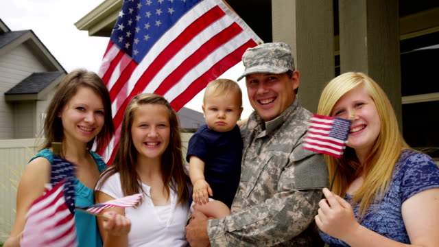 Portrait of American military family HD 1080p: Portrait of American military family veteran stock videos & royalty-free footage