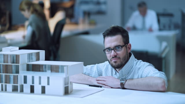 ds portrait of an architect by his architectural model - architect stock videos and b-roll footage