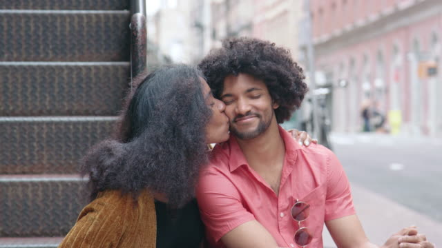Portrait of an Attractive African American Couple Kissing in the City - video