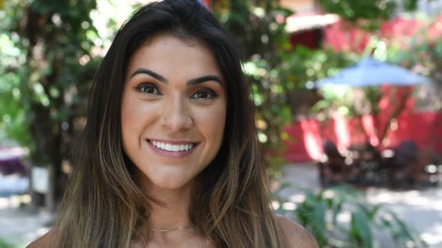 Portrait of an attractive Brazilian woman smiling to camera