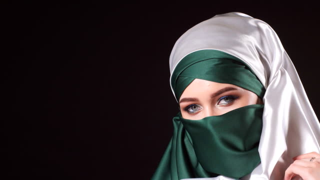 Portrait of an attractive young modern Muslim woman in hijab