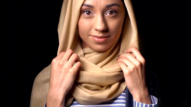 portrait of an attractive young modern muslim woman in hijab - abbigliamento modesto video stock e b–roll