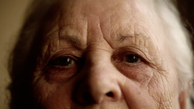 Portrait of an old woman. Close up video