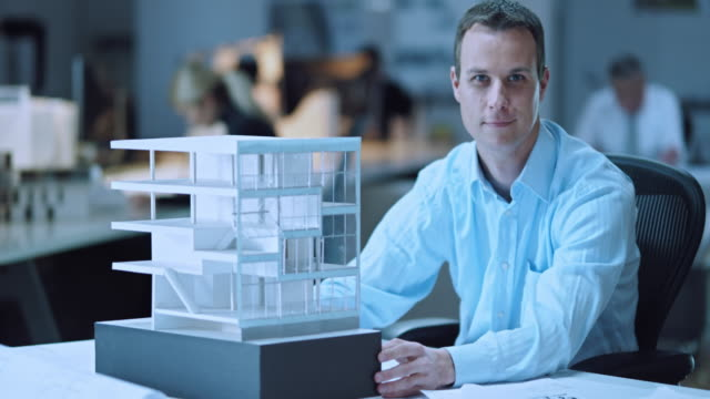 ds portrait of architect checking the architectural model - architect stock videos and b-roll footage