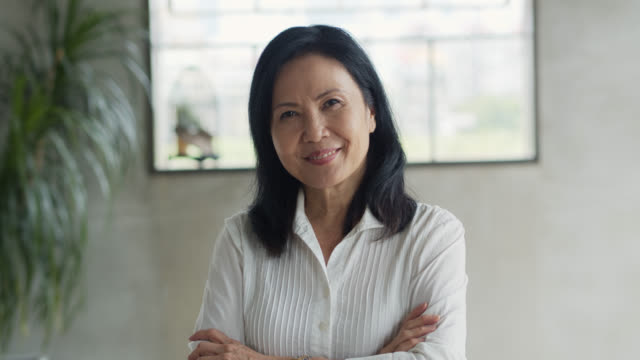 Portrait of Asian Businesswoman Crossing Arms