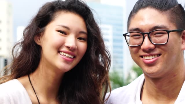 portrait of asian couple smiling - two students together asian video stock e b–roll