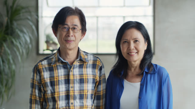 Portrait of Asian Man and Woman in their 50s - vídeo