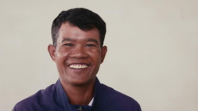 Portrait of Asian man looking at camera, people feelings video
